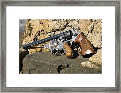 Two Hand Guns Framed Print by Susan Leggett