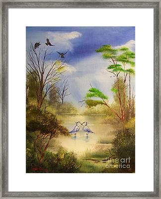 Two Herons Framed Print by Crispin  Delgado