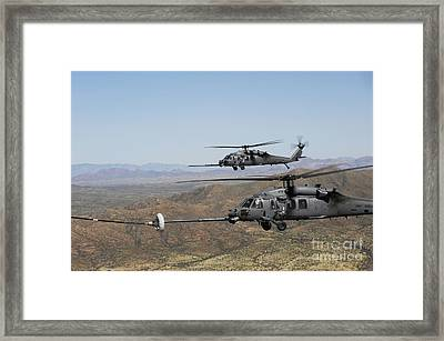 Two Hh-60 Pave Hawks Refuel Framed Print by Stocktrek Images