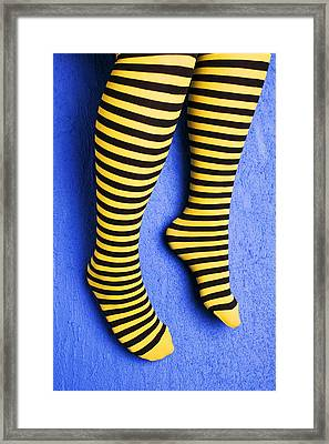 Two Legs Against Blue Wall Framed Print by Garry Gay