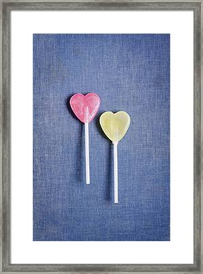 Two Lollipops On Blue Background Framed Print by Elke Vogelsang