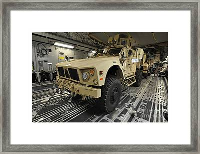 Two M-atvs Await Transport On A C-17 Framed Print by Stocktrek Images