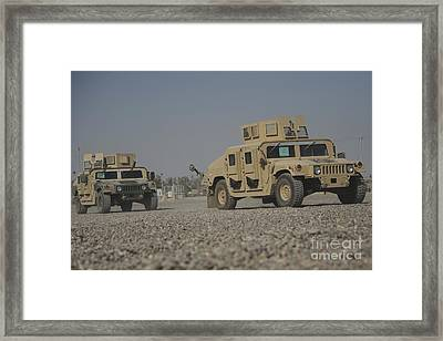 Two M1114 Humvee Vehicles At Camp Taji Framed Print by Stocktrek Images