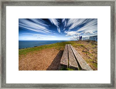 Two Men And A Dog Framed Print by Adrian Evans