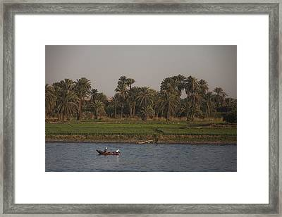 Two Men Fish In The Nile River Framed Print