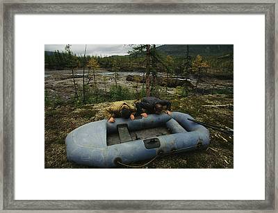 Two Men Use Lung Power To Top Framed Print by Randy Olson