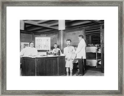 Two Recently Bathed Men Are Given Framed Print