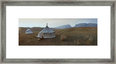 Two Traditional Yurts On A Flat Plain Framed Print by Phil Borges