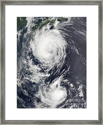 Two Typhoon Systems Approaching The Far Framed Print