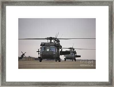 Two Uh-60 Black Hawks Taxi Framed Print by Terry Moore