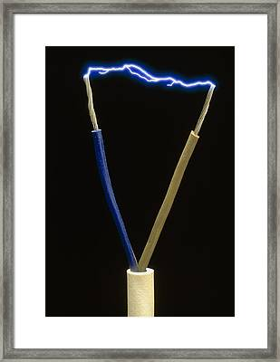 Two Wires Of A Plug Showing Spark Discharge Framed Print