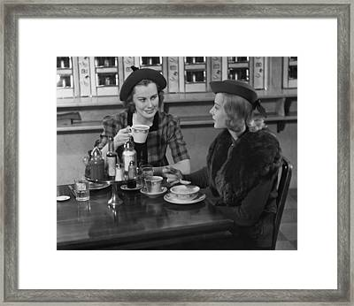Two Women At Restaurant Framed Print by George Marks