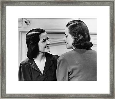 Two Women Conversing In Living Room, (b&w) Framed Print by George Marks