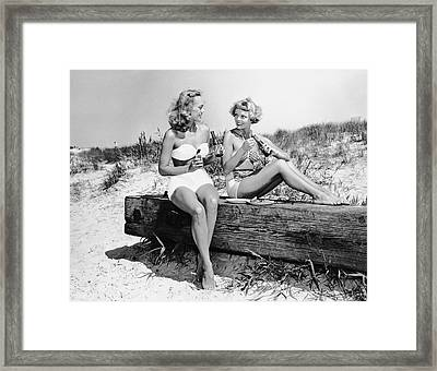 Two Women Drinking Soda On Beach Framed Print by George Marks