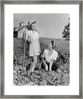Two Women Gardening In Field Framed Print by George Marks