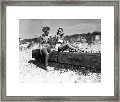 Two Women In Bikini Eating Snack On Beach, (b&w) Framed Print by George Marks