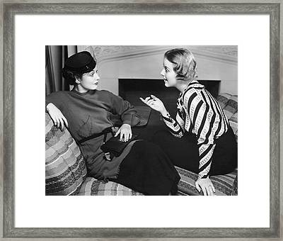 Two Women In Casual Conversation Framed Print by George Marks