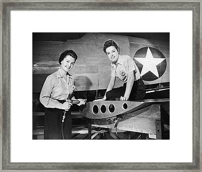 Two Women Working On Airplane Framed Print by George Marks
