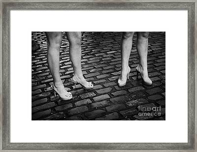 Two Young Women Wearing High Heeled Shoes And Fake Tan On Cobblestones On A Night Out In Dublin  Framed Print by Joe Fox