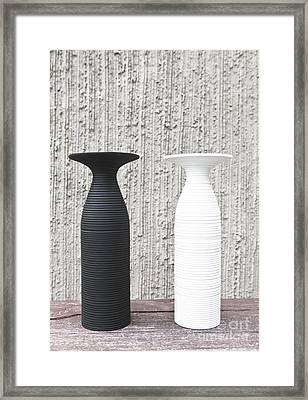 twoWhite and black vases Framed Print by Chavalit Kamolthamanon