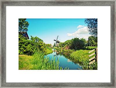 Framed Print featuring the photograph Typical Dutch  Windmill by Ariadna De Raadt