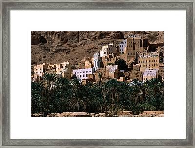 Typical Hadramawt Village With Date Plantation In Foreground, Wadi Daw'an, Yemen Framed Print by Frances Linzee Gordon