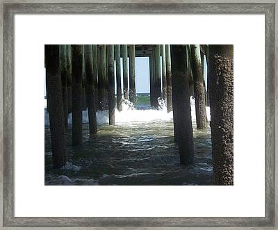 Under The Board Walk Framed Print by Jose  Ortiz