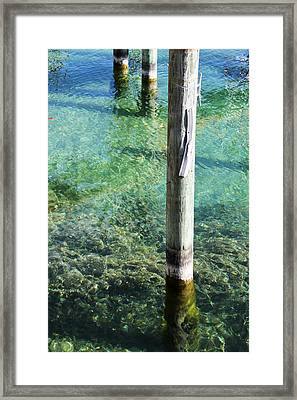 Under The Docks Framed Print by Sheryl Burns