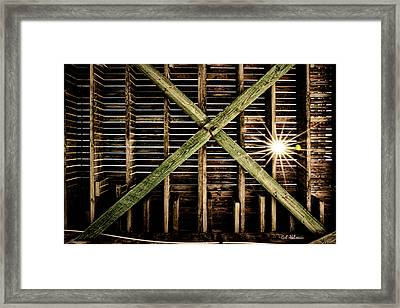 Under The Pier Framed Print by Christopher Holmes
