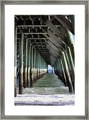 Under The Pier Framed Print by Teresa Mucha