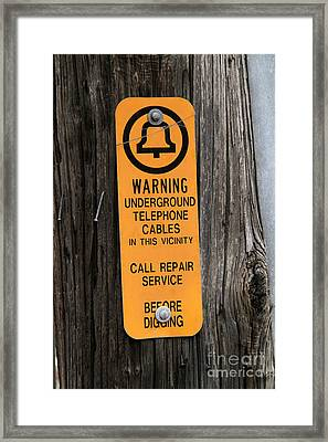 Underground Telephone Cable Sign Framed Print by Photo Researchers