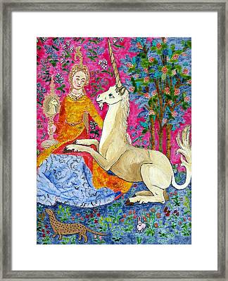 Unicorn And The Lady Framed Print by Phil Strang