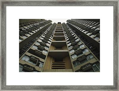Upward View Of A Public Housing Framed Print by Justin Guariglia