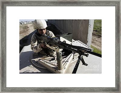 U.s. Air Force Airman Aims A M240b Framed Print by Stocktrek Images