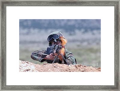 U.s. Air Force Airman Fires An Fnmi Framed Print