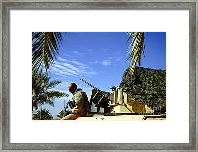 U.s. Air Force Airman Sits Framed Print by Stocktrek Images