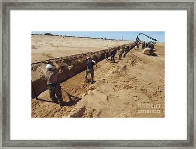 U.s. Air Force Airmen Dig A Trench Framed Print by Stocktrek Images