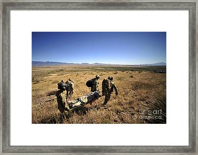 U.s. Air Force Pararescuemen Carry Framed Print by Stocktrek Images