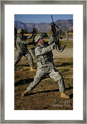 U.s. Air Force Soldier Practices Framed Print by Stocktrek Images