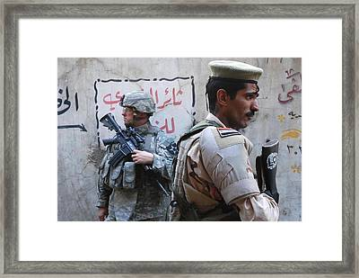 Us And Iraqi Army Soldiers Stand Guard Framed Print by Everett