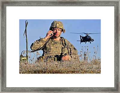 U.s. Army Captain Directs An Ah-64 Framed Print by Stocktrek Images