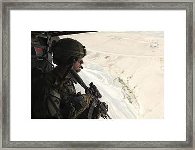 U.s. Army Captain Looks Out The Door Framed Print