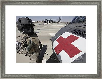 U.s. Army Crew Chief Inspects Framed Print by Stocktrek Images