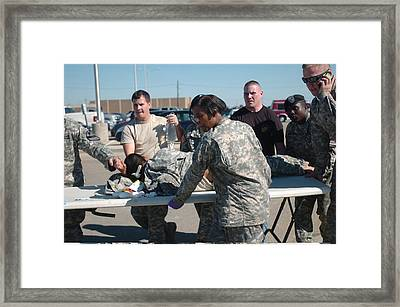 Us Army First Responders Use A Table Framed Print by Everett