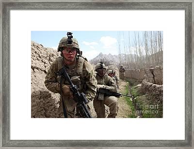 U.s. Army Platoon Moves In Behind Mud Framed Print