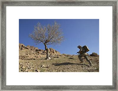 U.s. Army Soldier Climbing A Mountain Framed Print