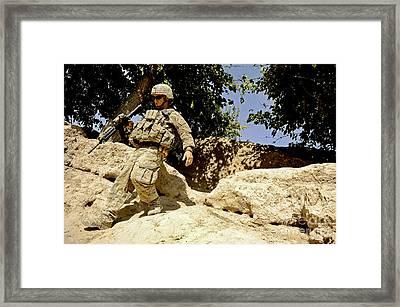 U.s. Army Soldier Climbs Down A Hill Framed Print