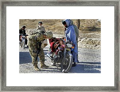 U.s. Army Soldier Conducts Vehicle Framed Print by Stocktrek Images