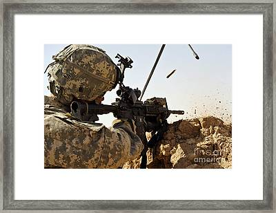 U.s. Army Soldier Engages Enemy Forces Framed Print by Stocktrek Images