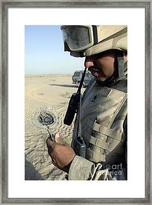U.s. Army Soldier Examines Ballistic Framed Print by Stocktrek Images